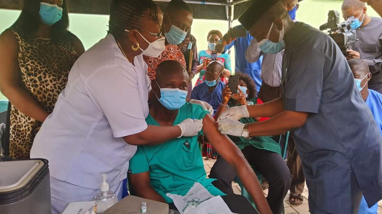 https://www.westafricanpilotnews.com/wp-content/uploads/2021/03/Vaccination-A-health-Worker-Recieving-AstraZeneca-COVID-19-Vaccine-3-15-21_WAP-Credit-1280x720.jpg